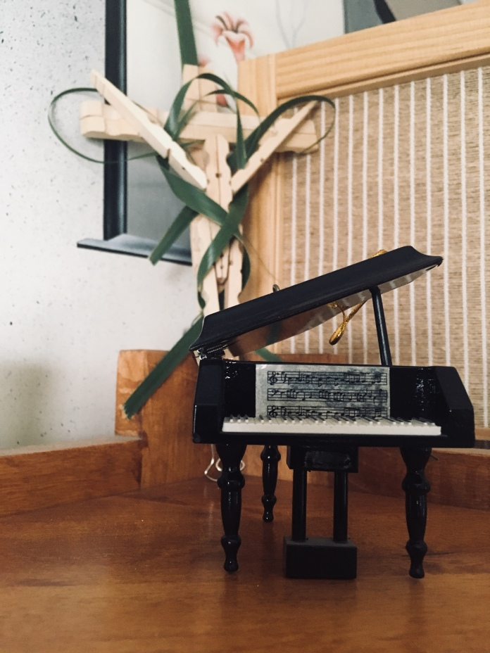 Cross with a Piano